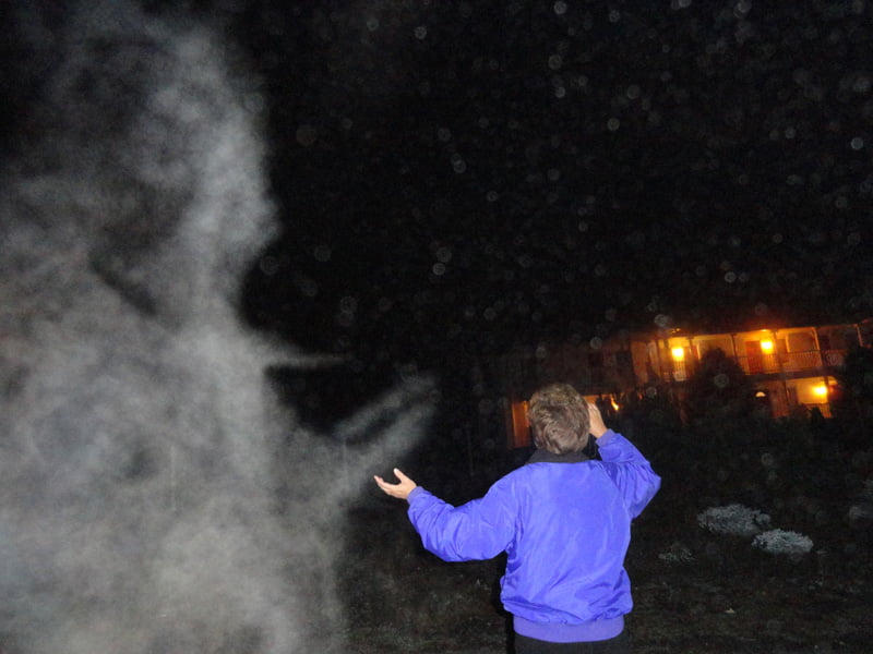 Alex Bennett photographed a visitor at Mountain Quest Institute with a Myst formation which seems to be interacting with the woman. Photo courtesy of Alex Bennett