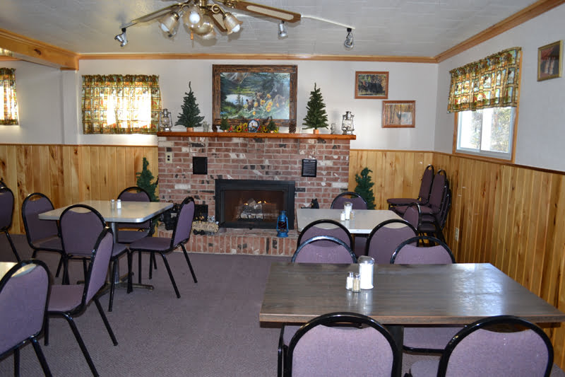 The Bear's Den restaurant in Arbovale is decked out with bear decorations and a cozy fireplace.