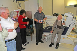 Members of the Pocahontas Memorial Hospital board learn about a new, improved hospital bed from Andy Aitken, area sales manager at Linet Americas, the bed manufacturer. The hospital is considering the purchase of 24 of the new beds at a cost of about $164,000. In the photo, left to right, board member Don McNeel, board member Janet Ghigo, Linda Tracey, Aitken and board member Amon Tracey.