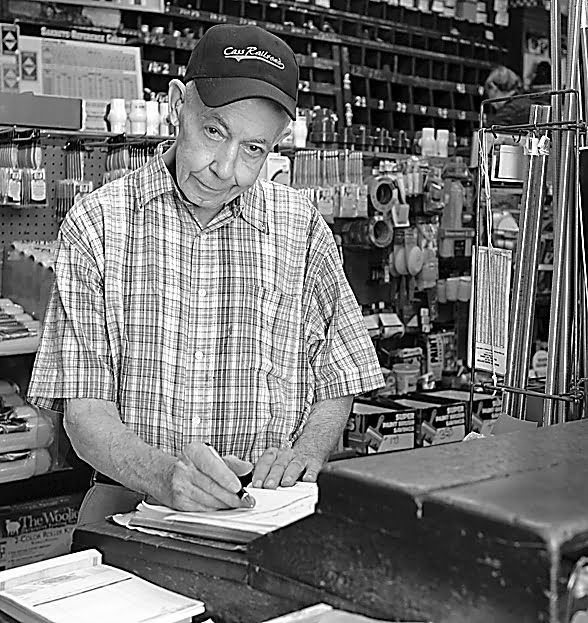 """Charles """"Googie""""Richardson at home at C.J. Richardson Hardware in Marlinton. Photo source: www.wvculture.org"""