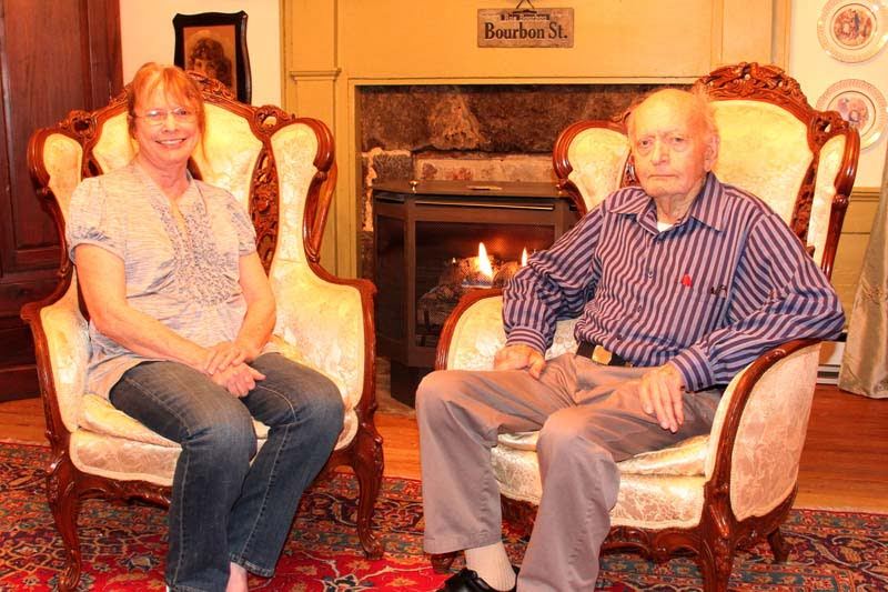 Retired Navy Lieutenant Commander Lee Stein with his wife Dixie in their historic Green Bank home. Stein navigated the first submarine to circumnavigate the globe in 1958. He met Dixie at a Yacht Club ball and they were married a month later.