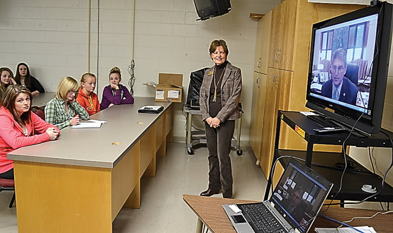 Senator Joe Manchin, on the TV screen, addressed questions asked by students in Sherman Taylor's Civics class at Pocahontas County High School. The Skype session was organized by Regional Coordinator Peggy Hawse, center.