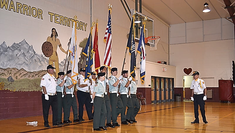 Seven members of the Pocahontas County High School Color Guard, joined by members of the Pocahontas County Veterans Honor Corps, present the colors at an assembly at PCHS Friday.