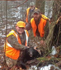 The United Special Sportman Alliance (USSA) and the Clear Creek Rod and Gun Club sponsored a bear hunting trip for a youngster from North Carolina last week. In the photo, John Dean, of Landis, North Carolina, shows off the black bear he killed on December 9. Dean overcame a variety of health issues and the hunting trip was a wish fulfilled by USSA and the hunt club. Next to Dean is Tom Provesis, who helped set up the trip. In the rear, Clear Creek member Porter Stanley. Photo courtesy Matt Dean.