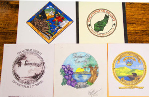 The Pocahontas County Commission will choose one of these five designs for a county seal during its meeting on December 17. The designs were submitted by: Top row, left to right: R. Hunter Hurt and Lucinda Tyler; Bottom row, left to right: Vang Vanmany, Patricia Cochran and Larry C. Taylor.