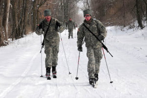 CrossCountrySkiing02: 10th Mountain Division soldiers cross-country ski on a groomed trail during the division's Mountain Winter Challenge at Fort Drum, N.Y. in February 2013. Soldiers participated in the ski biathlon to honor past mountain warriors and foster esprit de corps. Army photo.