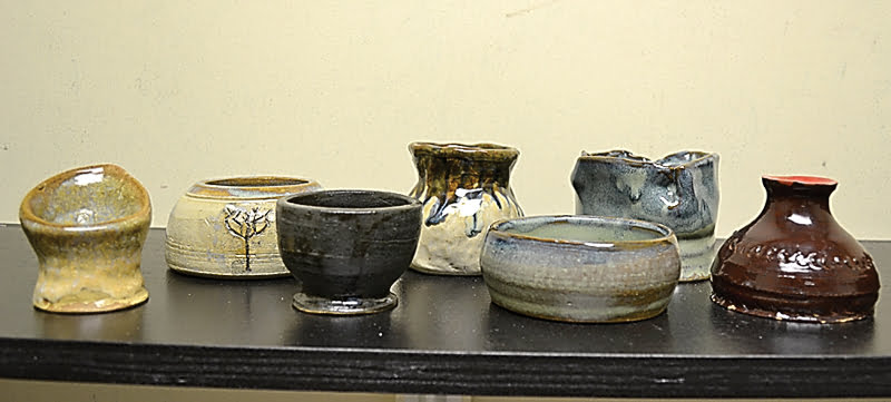 """After three classes, I managed to have seven pieces survive the wheel and kiln. One piece, the """"Calla Lilly""""on the far left, became an early Christmas gift for my mom. The others don't have recipients yet. S. Stewart photo"""