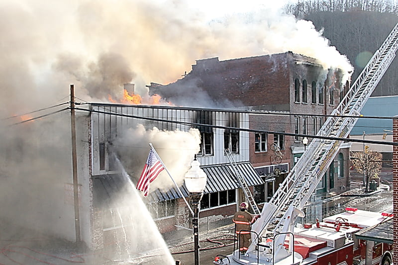Fire ripped through three buildings on Main Street Marlinton November 10, causing seven businesses and several families to lose everything. G. Hamill photo