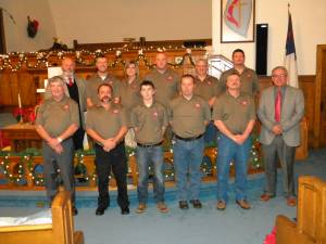 THE MARLINTON/EDRAY Methodist Charge held a special church service and a reception Sunday, December 29, at the Marlinton United Methodist Church to honor the first responders of the Marlinton Fire Department and Rescue Squad. Members pictured, front row, l to r: Tom Miller, Randy Sharp, Austin Sharp, J. P. Duncan, MFD Fire Chief Kenny Hall, and Rev. David Merryman of the Marlinton/Edray Charge. Back row, l to r: Assistant Pastor Sam Felton, Robbie Sharp, Jennifer Barlow, Herby Barlow, Randy Stemple and Doug Lantz. Photo courtesy of J. Barlow