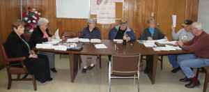Marlinton Town Council in session on December 2. In the photo, left to right: Councilmembers Sue Helton and Louise Barmnisky; Recorder Robin Mutdscheller; Mayor Joe Smith; and Councilmembers Loretta Malcomb, Norris Long and David Zorn.
