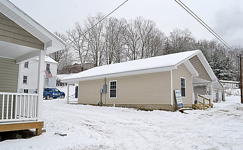 Three brand new houses await completion in Durbin. The Almost Heaven Habitat for Humanity houses may look finished but the interiors still have work to be done. AHHH is looking for volunteers to help finish the homes for the new year.  S. Stewart photo