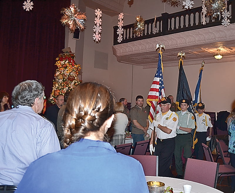 Donnie Waybright, front, and Harlan Whiting, of the Pocahontas County Veterans Honor Corps, joined by a member of the Pocahontas County High School Color Guard, present the colors at the Marlinton Woman's Club volunteer recognition dinner December 17 at the Pocahontas County Opera House. S. Stewart photo