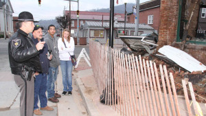 On Tuesday morning, Deputy Brian Shinaberry visited the site of the burned-out McK Building with a young couple he evacuated from the building on the morning of the fire that destroyed the building. In the photo, left to right, Shinaberry, Jerry Pennington, Caleb Arbogast and Destiny Penningon.