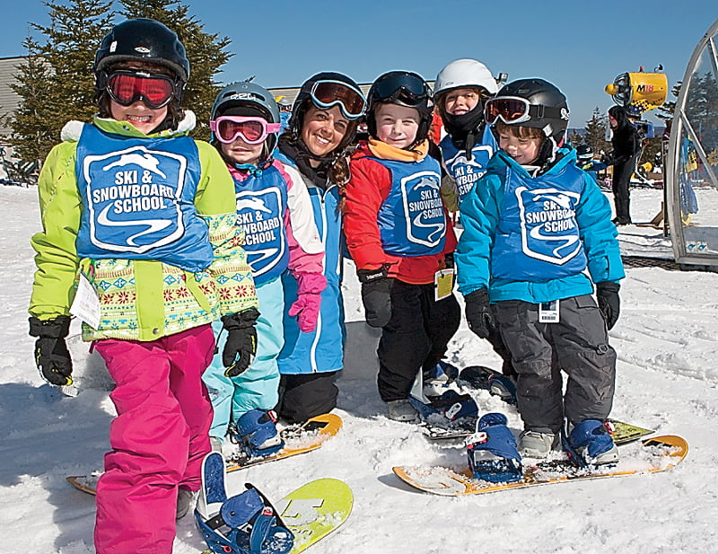 Ski School Instructor Brittany Melton, third from left, poses with her class of young snowboarders during the 2012-2013 winter season. Photo courtesy of Snowshoe Mountain Resort
