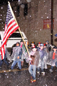 Cub Scouts of Marlinton Pack 33 braved a torrential downpour to march through the town's Christmas parade on December 6. Bands from the Pocahontas County High School and Marlinton Middle School also endured the elements and marched in the parade, inspiring a spirit of resilience and endurance in all observers.