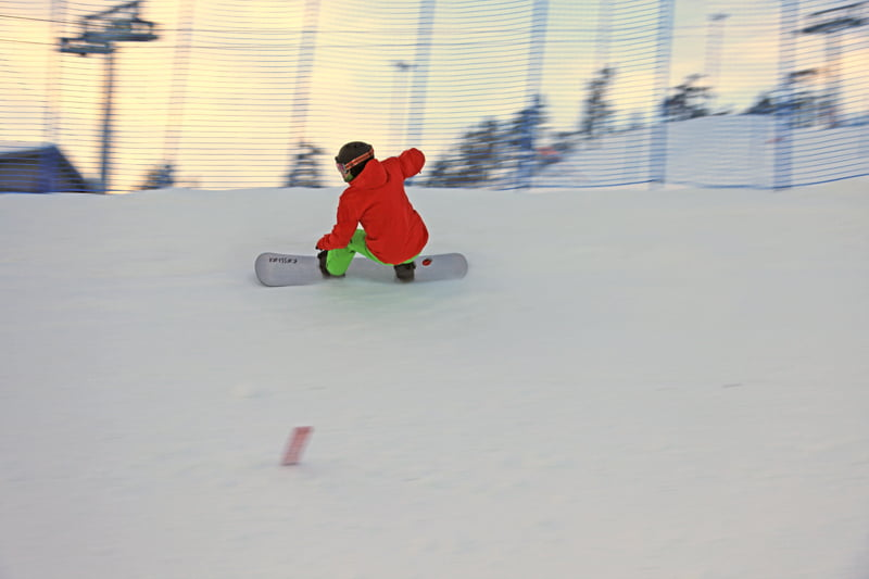 Snowshoe native Bobby Minghini on the slopes during a boardercross competition. All the racing and competing is leading up to a possible spot on the USAOlympic team. Photo courtesy of Bobby Minghini