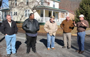 National Floodplain Insurance Program coordinators Robyn Mumphard and Greg McCann visited Marlinton on January 16 to discuss floodplain issues with Marlinton floodplain coordinator Dick Groseclose. During the visit, the officials visited Tenth Avenue, where Groseclose and Mayor Joe Smith described floodplain map discrepancies. In the photo, left to right: McCann, Mumphard, Smith, Groseclose and local insurance broker Greg Mosesso.