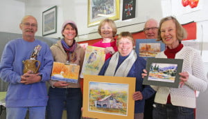 Members of the Pocahontas County Art Guild show off examples of their artwork on Saturday afternoon. The non-profit guild seeks to assist artists of all skill levels create artwork and learn new techniques. An annual membership fee of $25 covers basic supplies and instruction from other members. In the photo, left to right: Eric Stahl, Amy Cimarolli, Michelle Jeffers, Cyla Allison, Jack Gay and Ellie Gay.