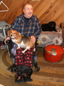 Andrew Taylor, of Wesley Chapel, with his dogs Jackie (on his lap), Sweet Pea (on his feet) and Isabel. Anyone who tries to take Jackie off of Taylor's lap gets growled at. Taylor said his dogs keep him company and make him laugh. The Pocahontas County Senior Citizens Program obtained a grant to provide free pet food for seniors' pets. Taylor received two large bags this month.