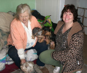 Marlinton Seniors Site Coordinator Beth Auldridge (right) with Ruby Walker and her three York Terriers, Itsy, Baby Yo and Foxy.