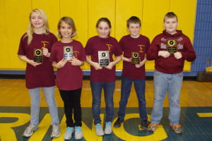 ArcheryTeam01: Pocahontas County school archery teams competed for the first time at a tournament at Shady Spring Middle School on February 22. The Elementary School Team dominated in their age group. The team won first place overall and had the three top scoring girls and two top scoring boys in the event. In the photo, left to right: 3rd Place girl Maria Workman, 2nd Place girl Haley Spencer, 1st Place girl Macaden Taylor, 2nd Place boy T.D. Sparks and 1st Place boy Jesse Bostic. Photo courtesy Heather Simmons.
