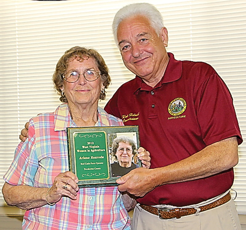 Arbovale farmer Arlene Rexrode receives the 2013 Woman in Agriculture award from West Virginia Agriculture Commissioner Walt Helmick. The ceremony was held last summer at the West Virginia State Fair. Photo courtesy of the State Agriculture Department