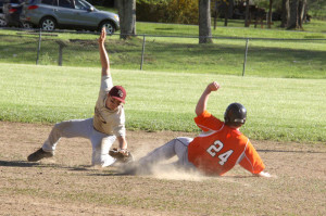 PCHS second baseman Wes Felton tags out a runner in a game against Richwood on May 5, 2013. Felton and fellow seniors Judd Walther,