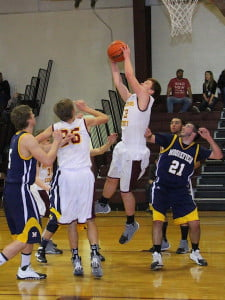 PCHS Warriors freshman Brady Jones grabs a rebound in a February 28 home game against Moorefield. Although the Warriors played well, the Yellowjackets took home a  58-48 victory. The young Warriors finished their cancellation-plagued regular season with a 6-13 record and begin sectional play this week.