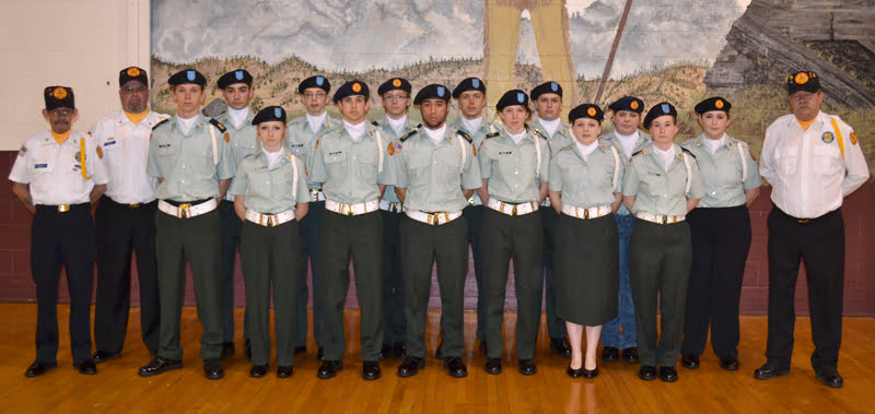 The Pocahontas County High School Color Guard has grown its ranks with the help of Pocahontas County Veterans Honor Corps members. The guard will perform services at spring and summer events in the county. From left: Honor Corps member Harlan Whiting, Honor Corps member Joe Arbogast, Adam Irvine, Philip Green, Bryce Kranc, David Rose, Cade Walker, Miles Goodall, Cary Robertson, Ryan Irvine, Brice Galloway, Curtis Kiner, Autumn Vance, Kristie Topper, Heather Pritt, Courtney Coetzee and Honor Corps member John McCollum. S. Stewart photo