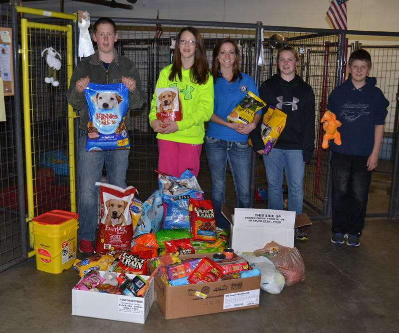 Green Bank Elementary-Middle School students collected food, treats and toys for the dogs and cats at the Pocahontas County Animal Shelter. From left, Troy Lusk, Haley Bennett, AmeriCorps Kristen Shinaberry, Hallie Kane and Justin Jackson stand with some of the donations given. S. Stewart photo