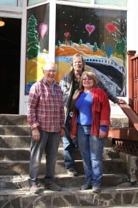 Members of the Pocahontas County Arts Council are working to renovate a building on Main Street in Durbin to become a new art gallery and visitor center. The Arts Council and Convention and Visitors Bureau are working on an agreement to station a CVB representative in the gallery during the summer months to sell artwork. In the photo, left to right: Arts Council President Art Kreft, Arts Council Treasurer Eric Werner and Arts Council Secretary Cynthia Guererri.