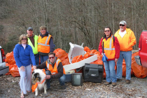 A group of nine volunteers spent their Saturday morning cleaning up an eight-mile stretch of Edray Road between Clover Lick and Route 66. In the photo, front row, left to right: Tina Runyon, Lacy the Collie and George Snyder; Back row, left to right: Tom Epling, Cyndy Epling, Judy Perry, Dwight Perry. Not pictured: Bob Runyon, Earl Tollman and Jennifer Snyder. Bob Runyon photo.