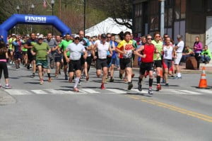 Team members start the Great Greenbrier River Race in Marlinton on Saturday. Team divisions included Coed, Family, Male, Female and Youth teams. Team members start the race after female and male solo racers.