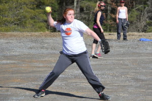 PCHS sophomore third baseman Emily Boothe throws out a runner in practice.