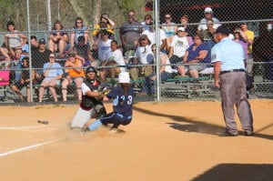 The umpire made the right call when PCHS catcher Sarah Lambert tagged out Pendleton County baserunner Brandy Roberts in a sectional playoff game last Thursday. Lambert's solid play behind the plate helped the Lady Warriors achieve their first-ever winning record in the regular season.