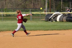 PCHS senior second baseman Bethany Arbogast throws out a runner in a sectional playoff game. Arbogast, the only senior on the PCHS roster, played her last game in a Pocahontas uniform.