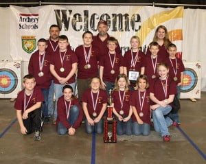 The Marlinton Elementary School archery team following its victory at the state tournament. Pictured, front row, l-r: Haden Mick, Macaden Taylor, Hazel Riley, Tess Kiner, Haley Spencer and Rayna Smith. Second row, l-r: T.D. Sparks, Jesse Bostic, Max Ervine, Silas Riley, Maria Workman, Conner Spencerand Frankie Burgess. Third row, l-r: Jody Spencer, Bob Simmons and Becky Spencer.