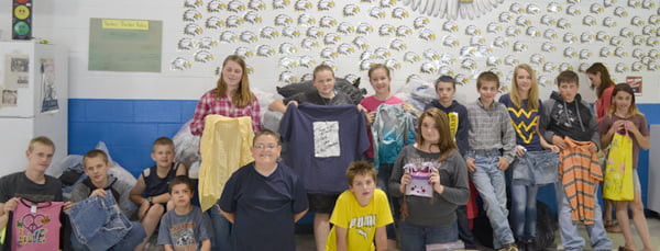 Green Bank Elementary-Middle School students display samples of clothing items they have collected for the clothing drive. Back row l-r: Kyle Cohenour, Matthew Queen, Justin Jackson, Hallie Kane, Bridget Carroll, Kaylee Halterman, Nathaniel Cottle, Andrew Via, Jennell Cassell, Wade McCarty, Frankie Tawney and Christin Shinaberry. Front Row l-r: Jeffrey Schebek, Jacob Taylor, Isaac Mace and Destiny Lane. S. Stewart photo