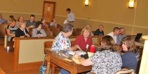 Ballot commissioners receive voter numbers from each precinct Tuesday night as members of the public await election results in the courtroom at the Pocahontas County Courthouse.