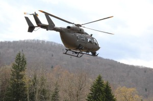 An Army National Guard Lakota helicopter lifts off during a search and rescue training exercise in the Monongahela National Forest last weekend. The exercise tested the ability of various military and civilian units to communicate effectively and operate together. The Lakota crew discovered the object of the search on Saturday morning - a simulated satellite that had crashed to the ground with radioactive contents.