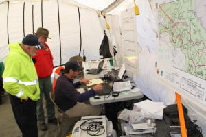 Dr. Don Ferguson, with the Mountaineer Area Rescue Group, uses a laptop computer to plot probable crash locations during a search and rescue operation near Cranberry Glades last weekend. Ferguson has more than 13 years of experience in search and rescue and has worked to integrate Geographic Information System software into search and rescue operations.