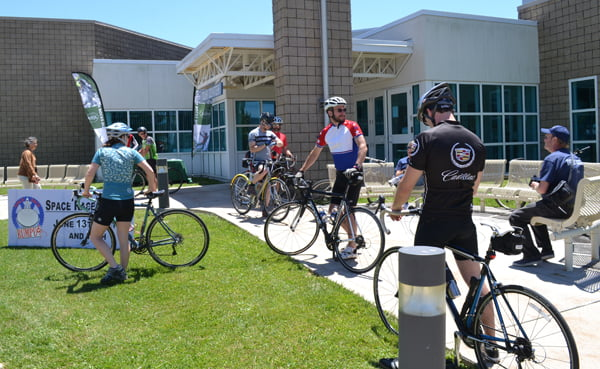 Cyclists gather in front of the National Radio Astronomy Observatory Science Center Saturday before heading out on a guided ride around northern Pocahontas County during the third annual Space Race Rumpus. S. Stewart photo