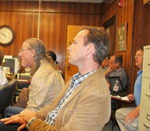 Pocahontas County Assistant Prosecutor Robert Martin, on the left, speaks to the County Commission on June 3, 2014. Martin told the commission he thought it was a bad idea to allow Snowshoe resident Richard Marker to speak about a proposed modification to a petition to create a resort area district at Snowshoe, because two public meetings on the petition have been scheduled in July. Seated to Martin's left is Snowshoe president and CEO Frank DeBerry. Marker is on the right in the photo.