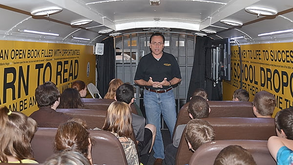 Mattie C. Stewart Foundation presenter Lynn Smelley talks to students at Marlinton Middle School on the Choice Bus. The program shows students what can happen if they choose to drop out of school. The back half of the bus is outfitted with a prison cell to show students the consequences of bad choices. S. Stewart photo
