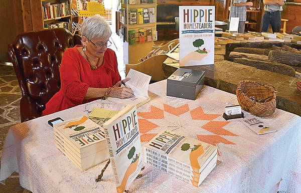 """West Virginia native and author Carter Taylor Seaton at an afternoon book signing at Linwood Community Library Sunday for her new book """"Hippie Homesteaders."""" During the event, Seaton gave a presentation on her process of collecting information for the book, which follows the influx of """"hippies"""" moving into West Virginia during the 60s and 70s. S. Stewart photo"""