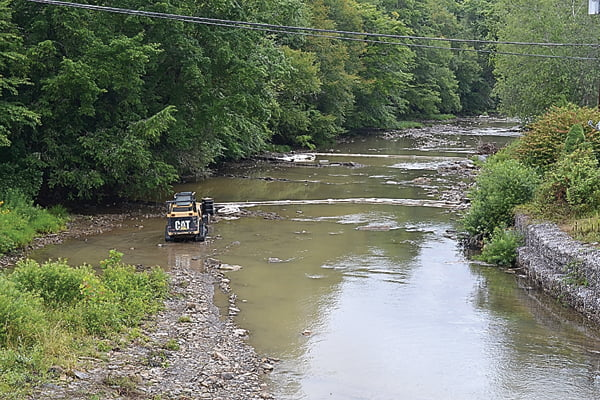 Chemical spill booms and pads collect diesel in the East Fork of the Greenbrier River in Bartow after the tanker truck wreck last week. The truck caught fire and officials are unsure how much of the diesel leaked into the river. S. Stewart photo