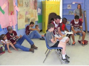 Members of the Pocahontas County High School football team took a break from summer workouts to read with students in the Energy Express summer learning program last Friday. Players participated in a number of interactive games, art and reading activities. Energy Express is a WVU Extension Service 4-H Youth Development program, supported by Americorps volunteers.