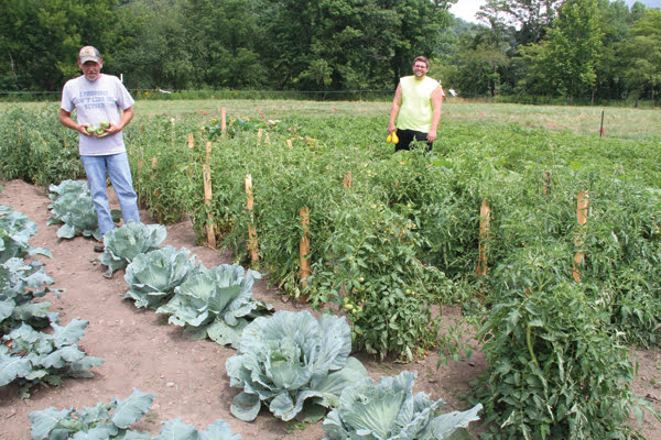 DAYREPORTCENTER Director Tammie Alderman reported to the County Commission about the success of the Center's gardening project. Produce from the garden is distributed through the local food bank as well the Pocahontas County Senior Citizens organization. The project will be expanded next year as a means to develop skills of the gardeners and provide even more fresh vegetables for county residents. G. Hamill photo