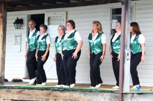 The Spring Hollow Cloggers, from Verona, Virginia, perform on Saturday at the Sydenstricker House.