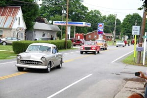 Classic car owners drive their cars through the Little Levels Heritage Fair parade.